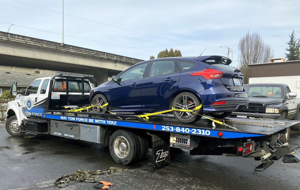Tow Equipment vehicle secured with four point tow straps
