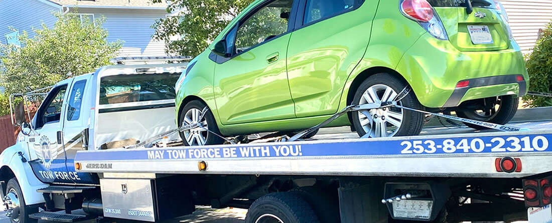 Tow - Green Chevy compact - Lakewood