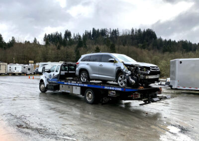 Transporting an SUV from Eatonville to Lacey for collision damage repair.